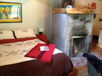 The queen size bed and fireplace